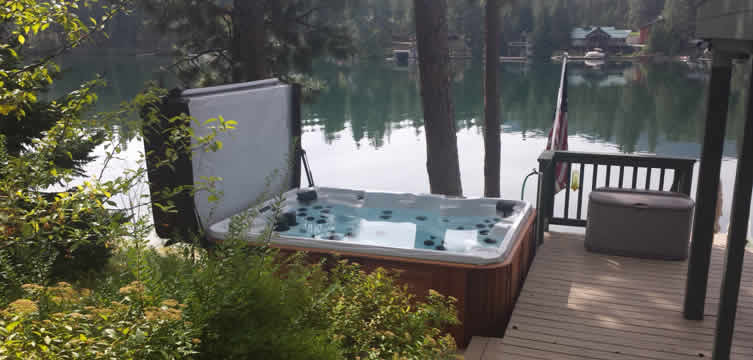 Here is our most popular hot tub shown with Platinum Swirl acrylic and cedar cabinet in a nice lake home setting.